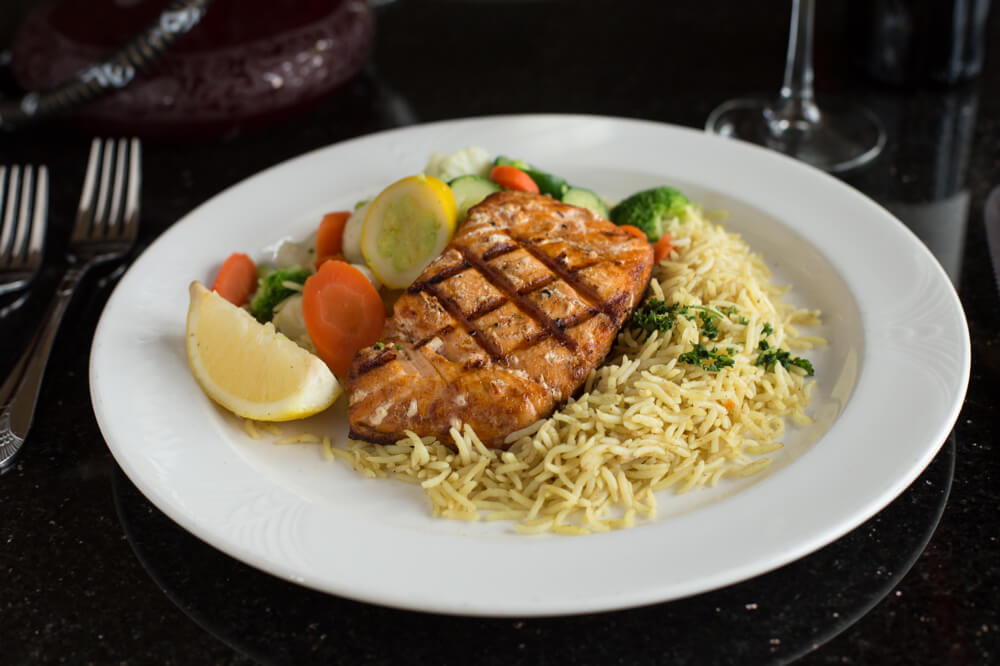 "Alt=""salmon dinner with basmati rice and steamed vegetables."""